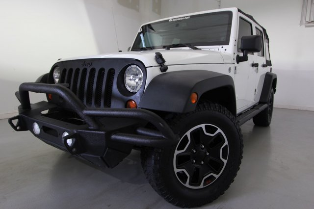 Pre-Owned 2013 Jeep Wrangler Unlimited Freedom Edition
